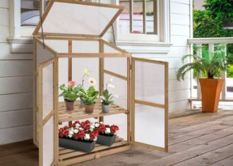 mini portable wooden garden greenhouse on terrace